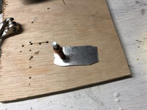 Metal piece cut and ready to drill the holes