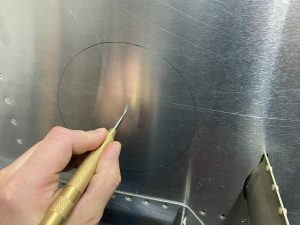 Using the center punch to mark the pilot holes