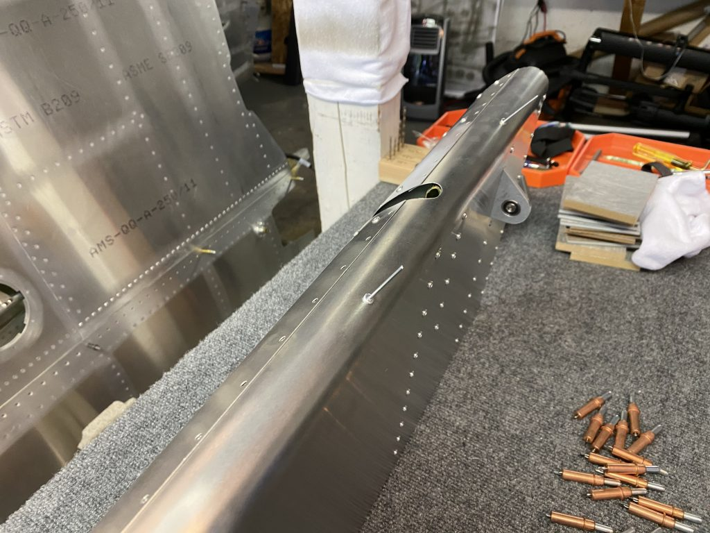 Riveting the balance tube